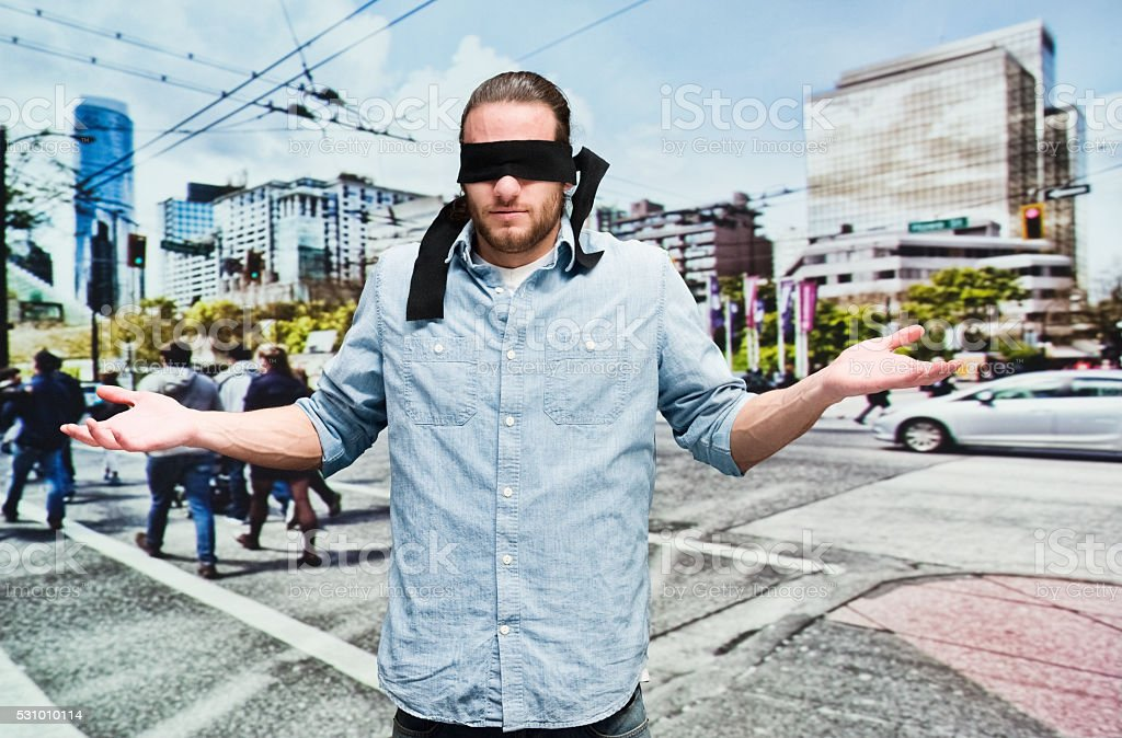 Rear view of blindness man searching outdoors stock photo
