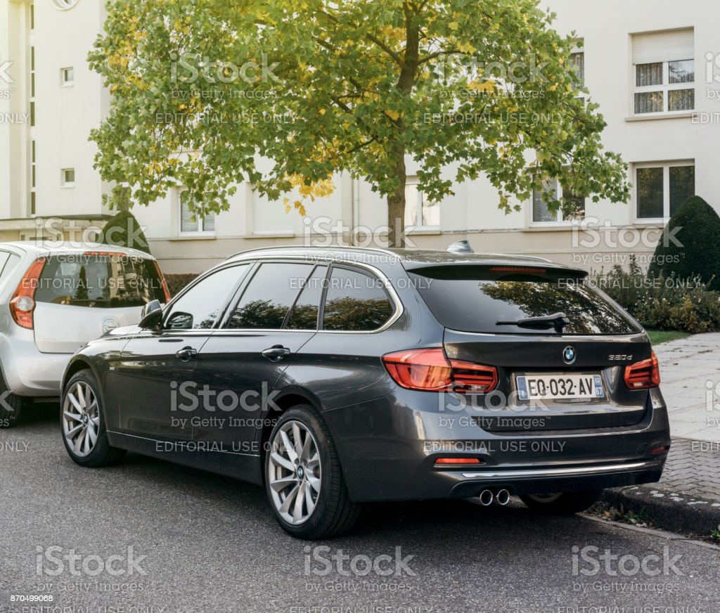 Rear View Of Bmw 320d Wagon Luxury Car Parked Stock Photo