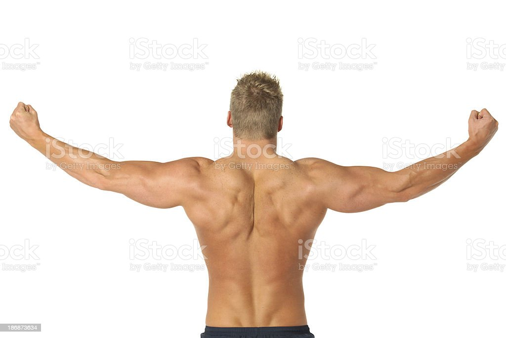 Rear View Of Body Builder Flexing Arms And Back Muscles Stock Photo