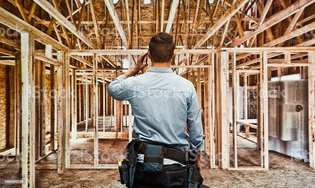 Rear view of building contractor on...