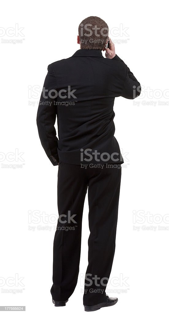 Rear view of business man in black royalty-free stock photo