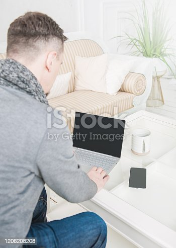 1151920695 istock photo Rear view of business man using laptop at home. Freelance or study concept 1206208208