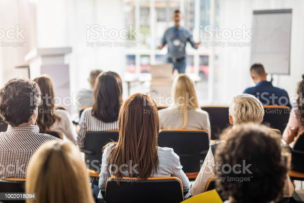 Rear View Of Business People Attending A Seminar In Board Room Stock Photo - Download Image Now