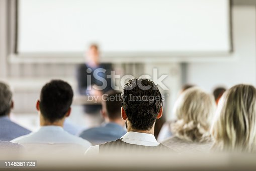 istock Rear view of business seminar in a board room. 1148381723