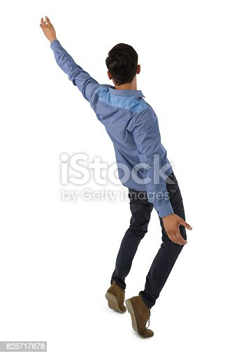 istock Rear view of businessman balancing 825717678