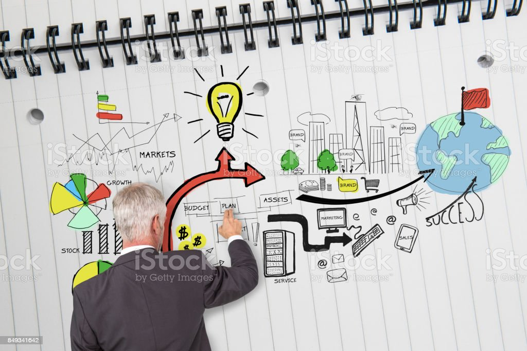 Rear view of businessman drawing economical graphics stock photo