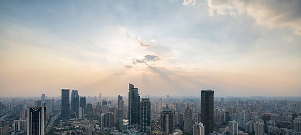 Rear view of businessman looking at sunset above shanghai city – Foto