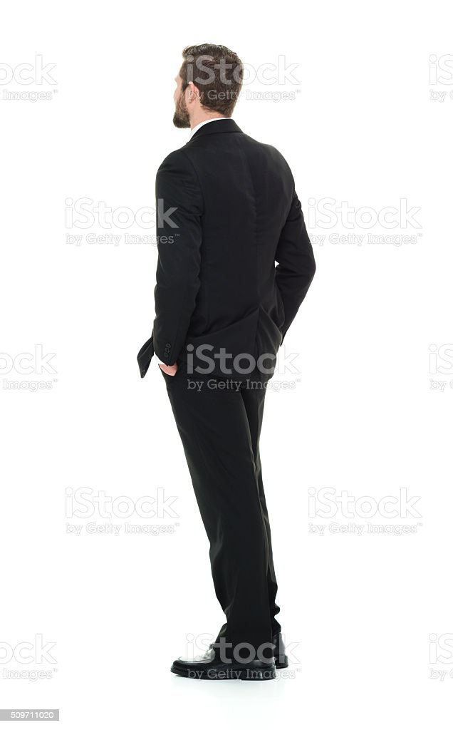 Rear view of businessman looking away stock photo