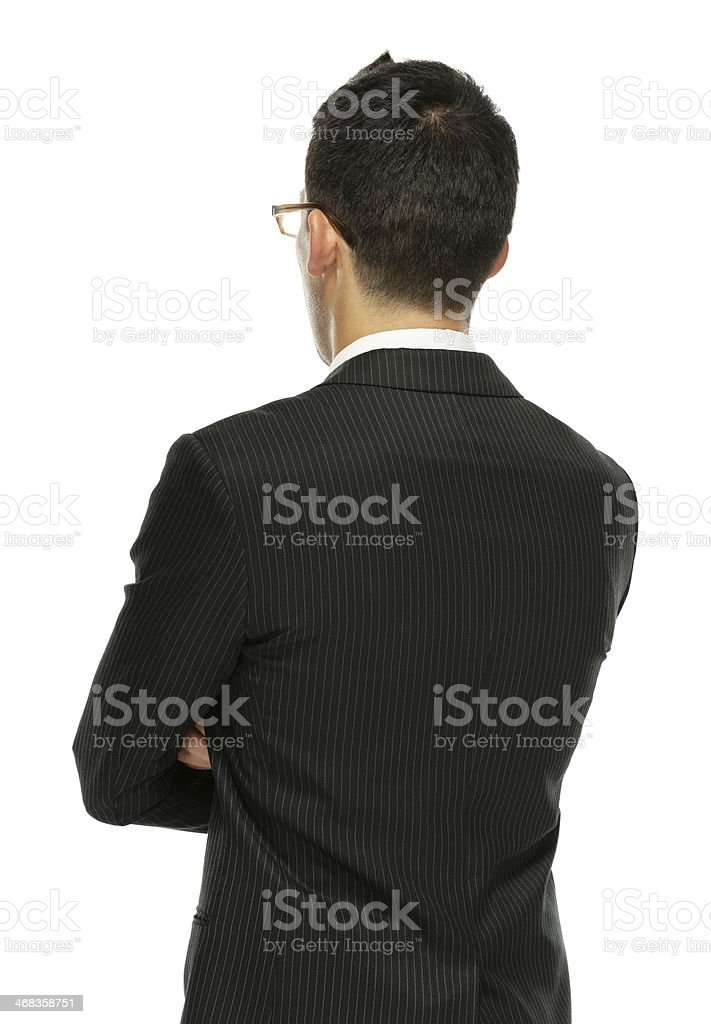 Rear view of businessman standing with arms crossed royalty-free stock photo