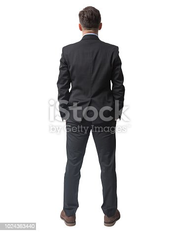 Rear view of businessman standing with hands in pockets