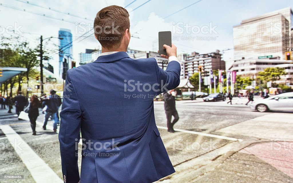 Rear view of businessman taking a...