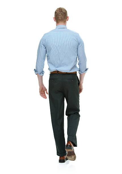 Rear view of businessman walking stock photo