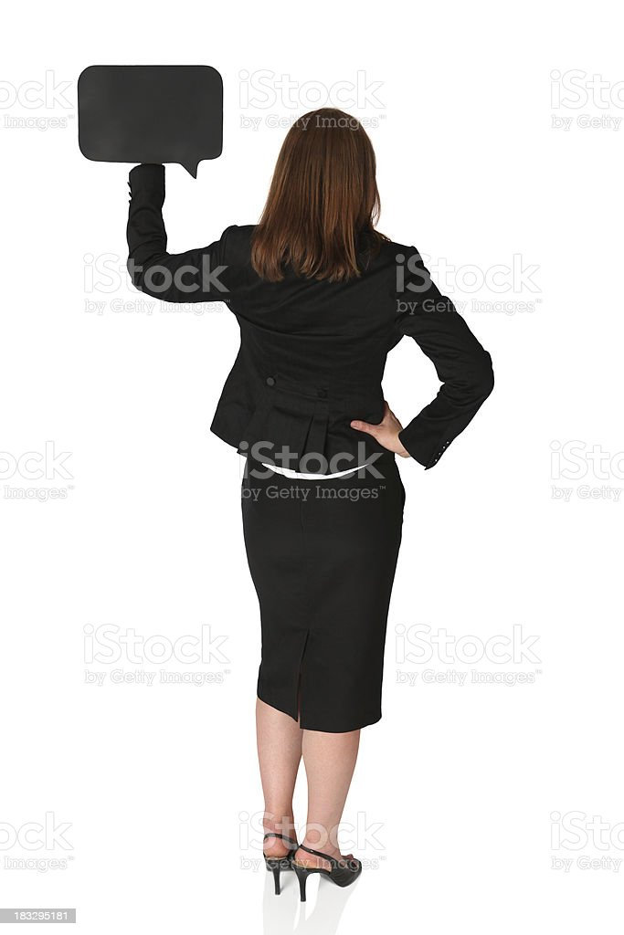 Rear view of businesswoman holding a speech bubble royalty-free stock photo