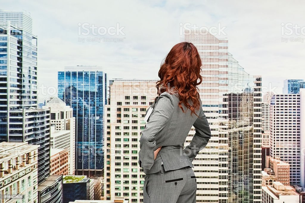 Rear view of businesswoman looking at...