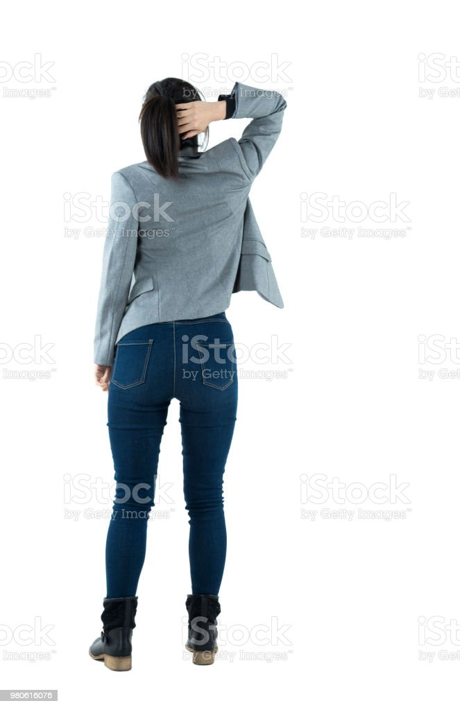 Rear view of businesswoman scratching her head stock photo