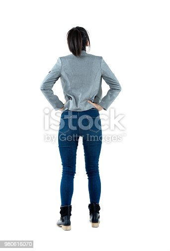 istock Rear view of businesswoman standing 980616070