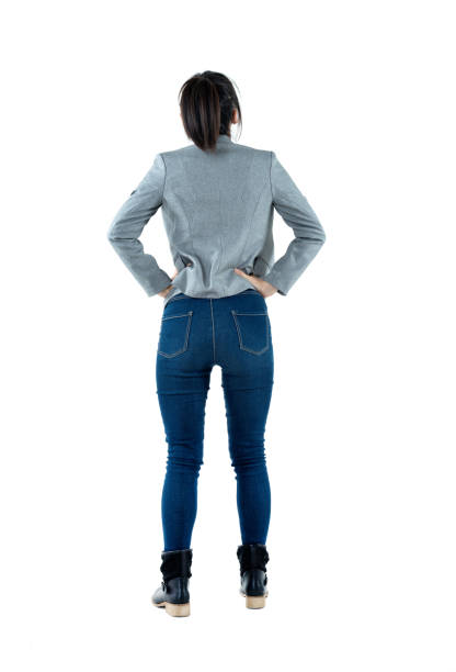 rear view of businesswoman standing - rear view stock pictures, royalty-free photos & images