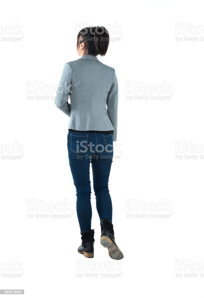 Rear view of businesswoman walking stock photo