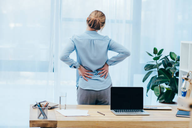 rear view of businesswoman with backplain in office stock photo