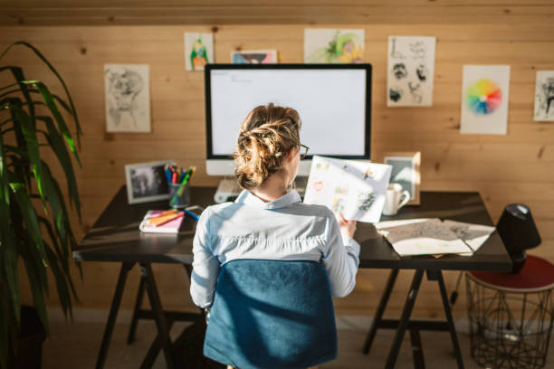 Rear View Of Businesswoman Working In Creative Office stock photo