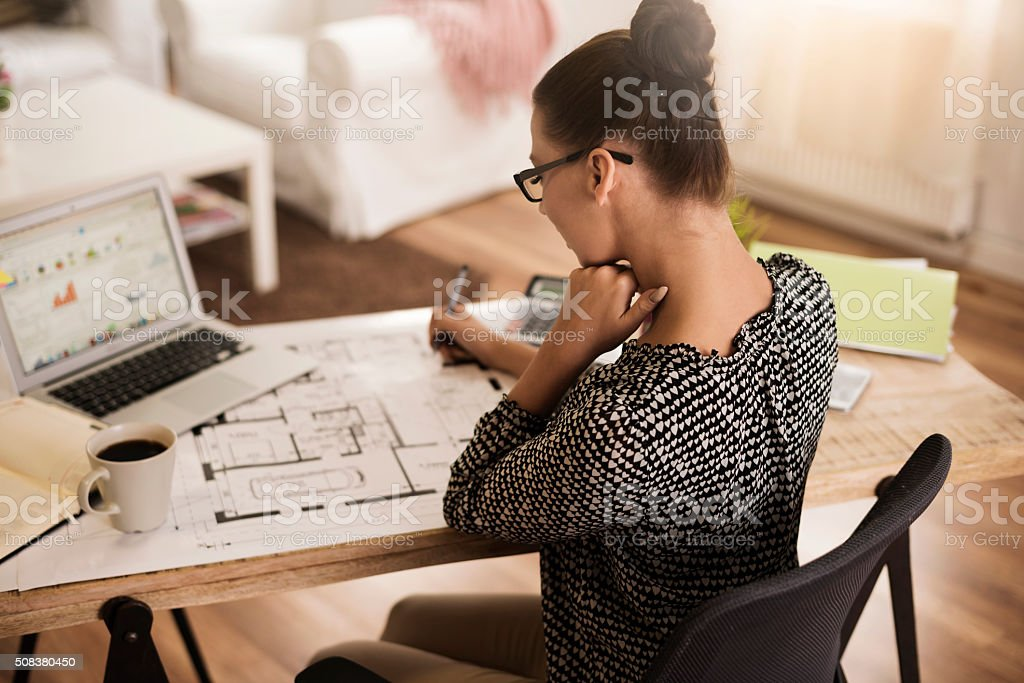 Rear view of busy woman at the office stock photo