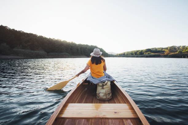 Rear view of canoeist girl stock photo