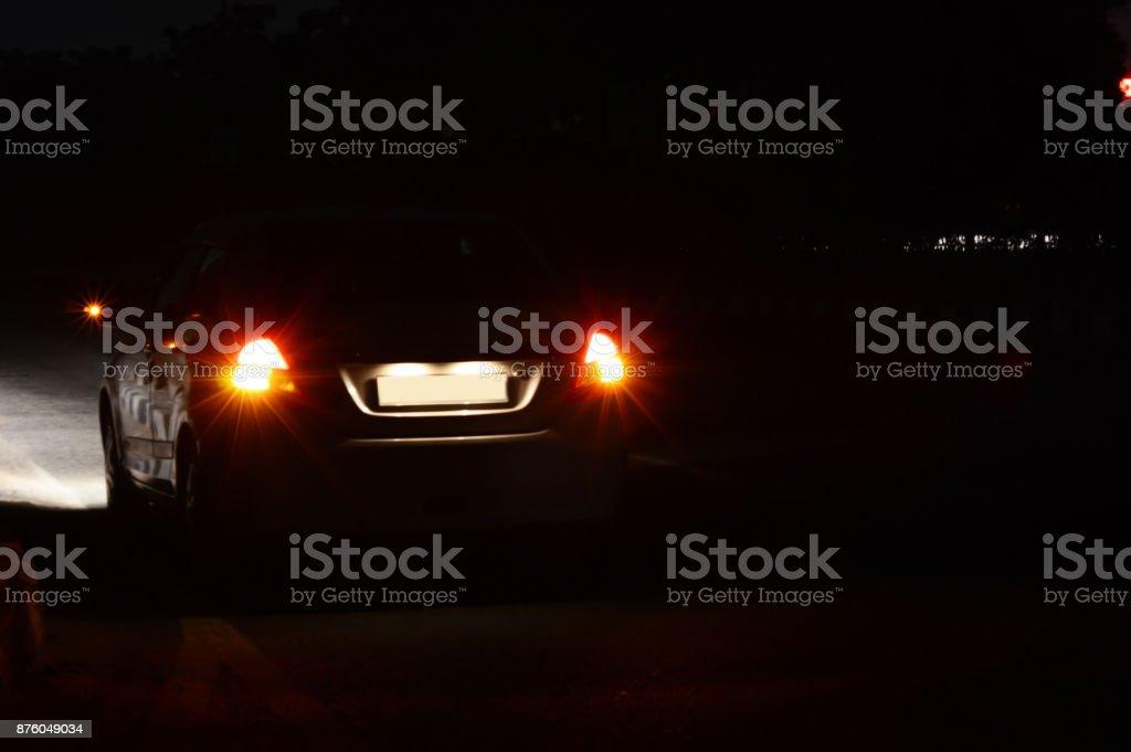 Rear view of car at night stock photo