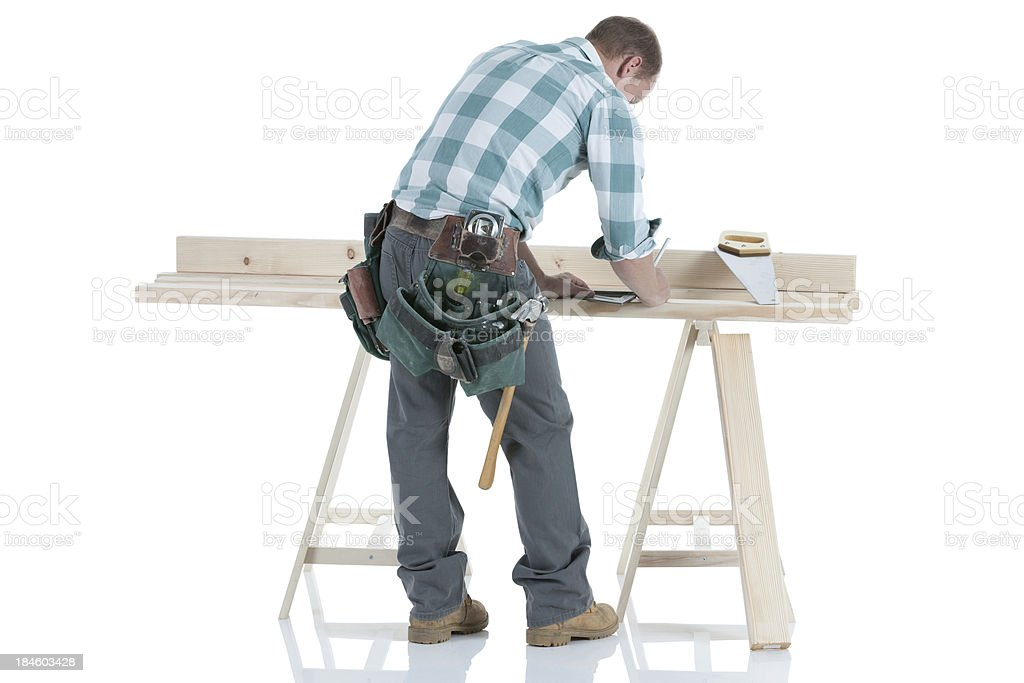 Rear view of carpenter working stock photo