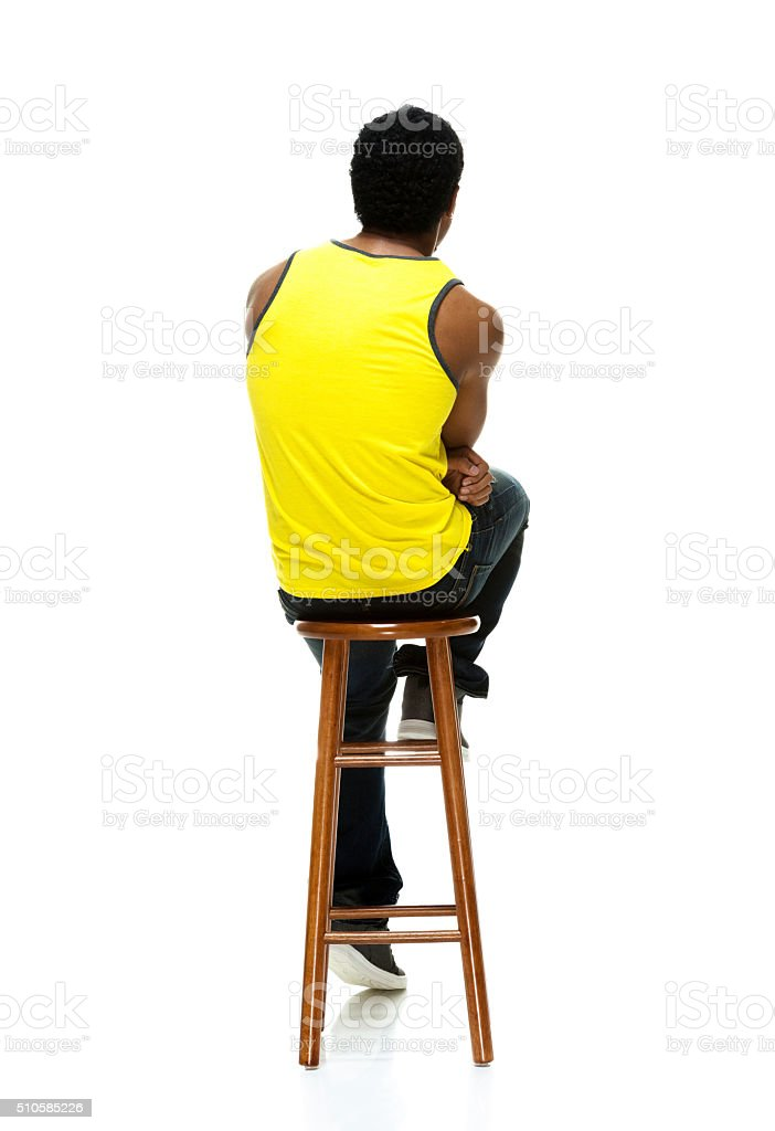 Swell Rear View Of Casual Male Sitting On Stool Stock Photo Lamtechconsult Wood Chair Design Ideas Lamtechconsultcom