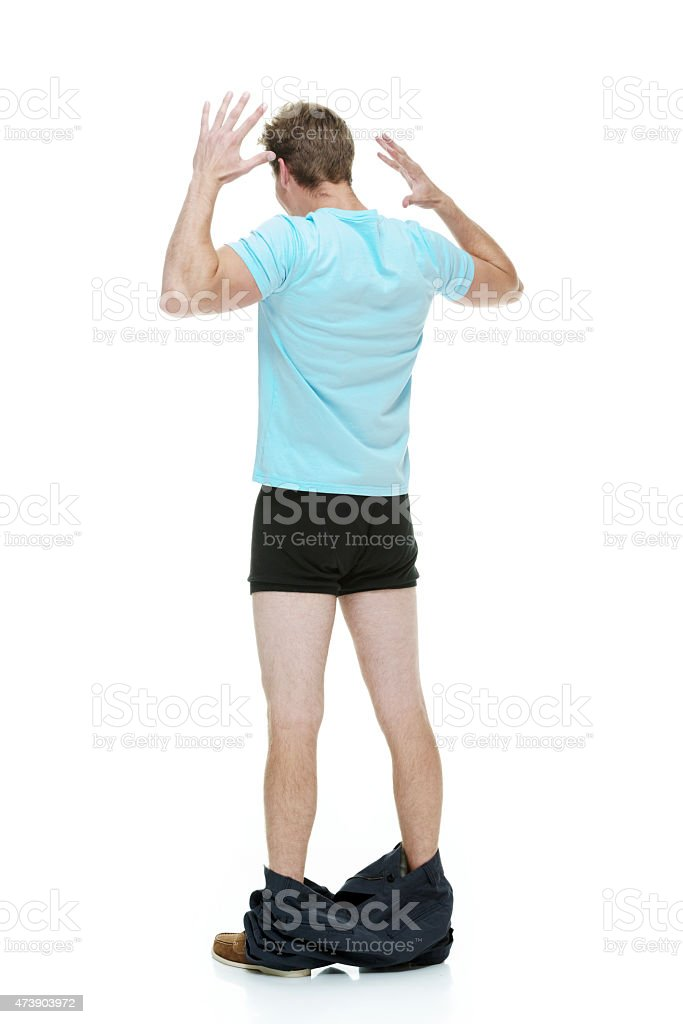 Rear view of casual man caught with his pants down stock photo