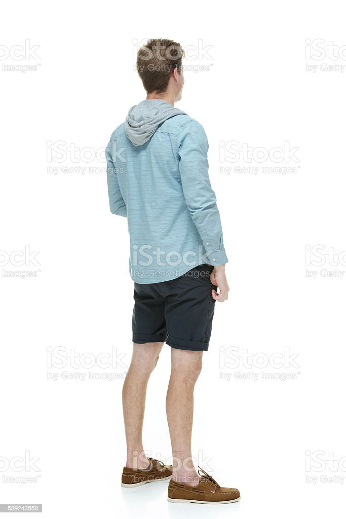 Rear view of casual man looking away royalty-free stock photo