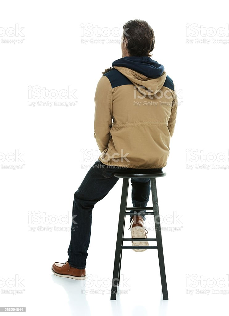 Rear View Of Casual Man Sitting On Stool Stock Photo More Pictures Of 20 24 Years Istock