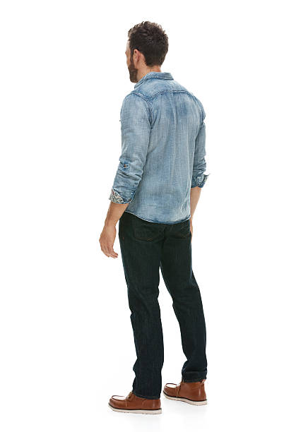 rear view of casual man standing and looking away - rear view stock photos and pictures