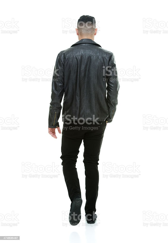 Rear view of casual man walking stock photo