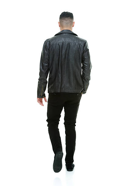 Rear view of casual man walking Rear view of casual man walkinghttp://www.twodozendesign.info/i/1.png leather jacket stock pictures, royalty-free photos & images