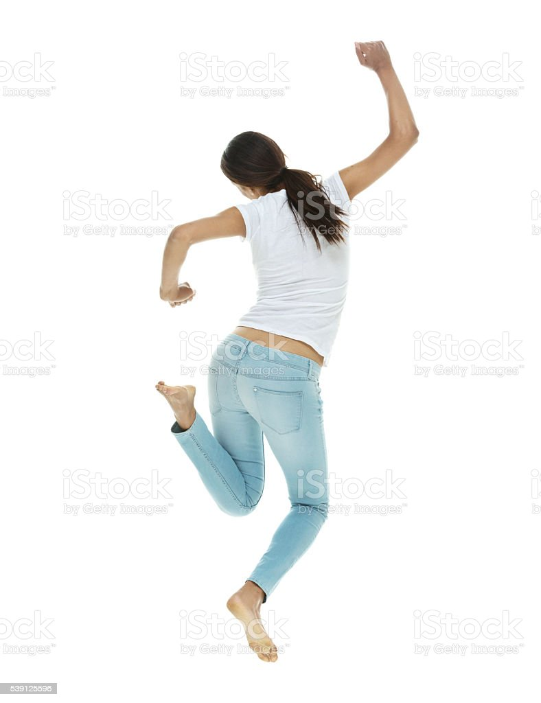 Rear view of casual woman cheering and jumping stock photo