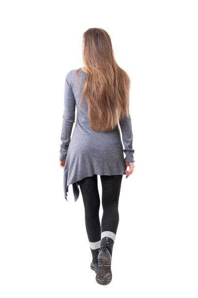 Rear view of casual young stylish woman with long flowing hair leaving Rear view of casual young stylish woman with long flowing hair leaving. Full body isolated on white background. rear view stock pictures, royalty-free photos & images