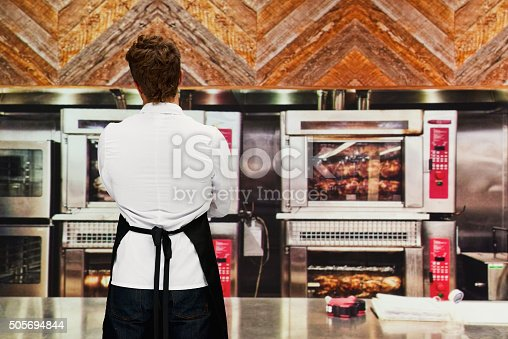 Rear view of chef in kitchenhttp://www.twodozendesign.info/i/1.png