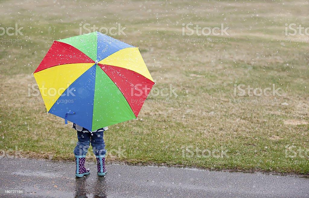 Rear View of Child & Umbrella royalty-free stock photo