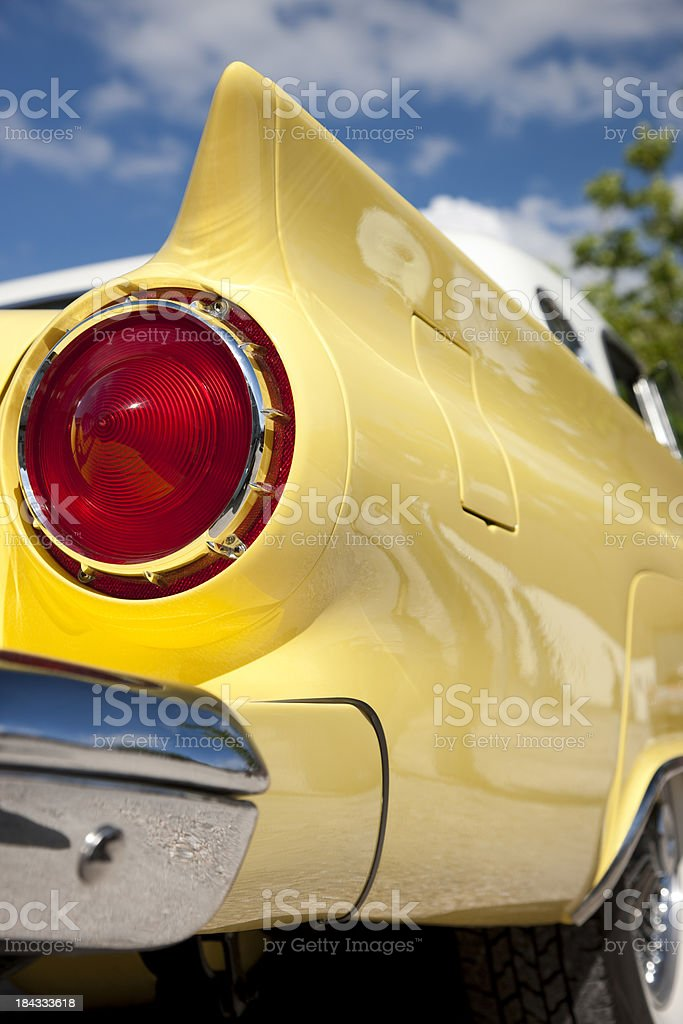 Rear View of Classic Car Against Blue Sky royalty-free stock photo