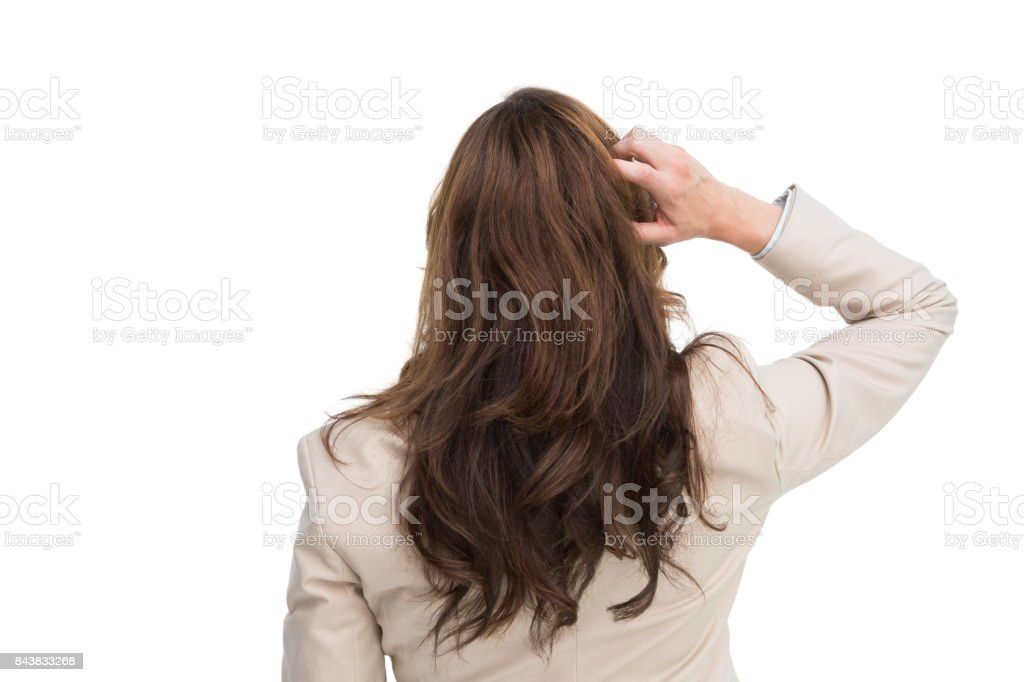 Rear view of classy businesswoman scratching her head stock photo