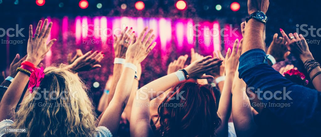 Concert crowd with raised hands