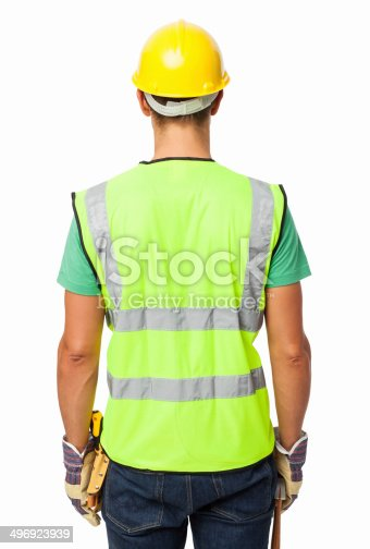 Rear view of construction worker wearing reflective clothing over white background. Vertical shot.