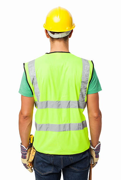 Rear View Of Construction Worker Wearing Reflective Clothing stock photo