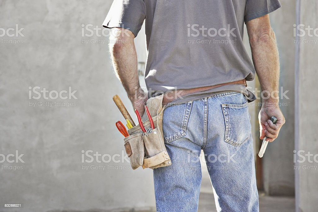 Rear view of construction worker's tool belt stock photo