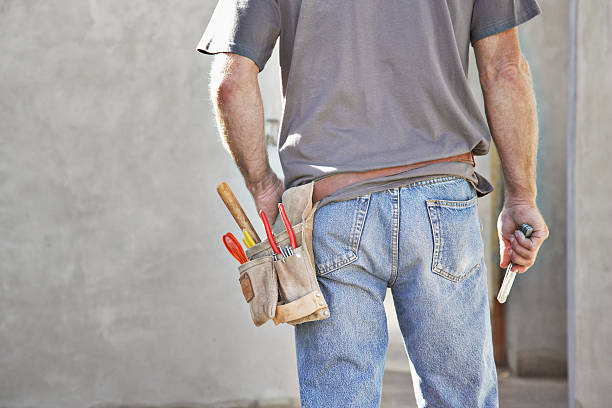rear view of construction worker's tool belt - tool belt stock photos and pictures