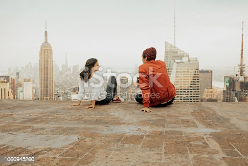 istock Rear view of couple embracing in New York 1060945260