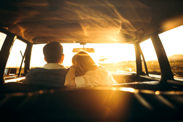 Rear view of couple in car stock photo