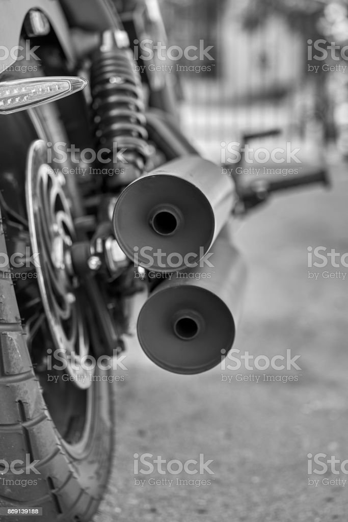 rear view of custom motorcycle, exhaust tips showing off stock photo