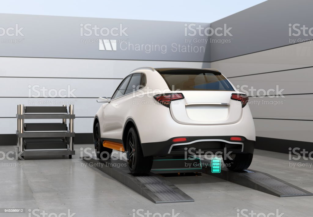 Rear view of electric SUV car exchange battery in battery swapping station stock photo